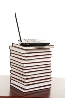 Free Black New Laptop Over Books Stack Royalty Free Stock Images - 18959989
