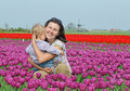Free In Tulip Field. Mother With Son In Tulips Field Stock Photo - 18966710