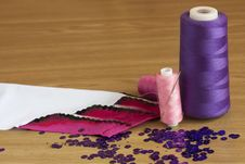 Free Spools  Thread And Fabric With Embroidery Royalty Free Stock Photo - 18960455