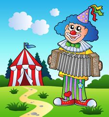 Free Clown Playing Accordion Near Tent Stock Photo - 18966020