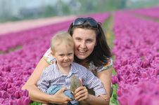 Free In Tulip Field. Mother With Son In Tulips Field Royalty Free Stock Image - 18966796