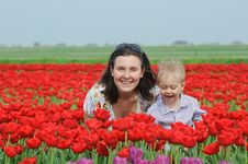 Free In Tulip Field. Mother With Son In Tulips Field Stock Photo - 18966860