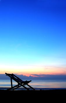 Free One Deckchairs On Beach At Sunset Royalty Free Stock Images - 18967299