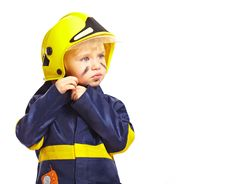 Free Boy In Fireman Costume With Helmet Royalty Free Stock Photography - 18971647