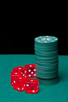 Poker Chips Column With A Set Of Dice Royalty Free Stock Photos