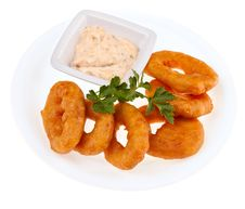 Fried Squid Rings With A Cheese Sauce Royalty Free Stock Image