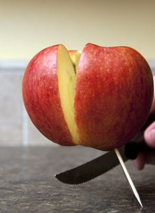 Free Apple Being Cut In Half Royalty Free Stock Image - 18973926