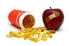 Apple And Capsules Royalty Free Stock Photo
