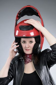 Free Young Biker Arranging Helmet Royalty Free Stock Image - 18975076