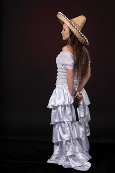 Free Mexican Girl Hold Revolver Stock Photography - 18977922