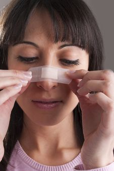 Free Applying Bandage On Nose Stock Photography - 18980512