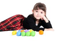 Adorable Little Girl Lying Down With Easter Eggs Royalty Free Stock Image