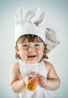 Young And Pretty Little Cook Royalty Free Stock Photo