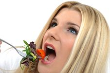Pretty Woman Eating Green Vegetable Salad Stock Images