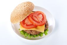 Free Cheeseburger With Tomatoes And Lettuce Stock Image - 18989921