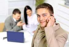 Free Young Smiling Businessman Calling Stock Photos - 18991383