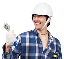 Young Worker Holding Spanner And Smiling Stock Photo