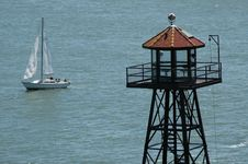 Free Tower And Sailboat In Ocean Royalty Free Stock Photography - 198887