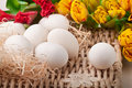 Free Eggs And Flowers Lying On Straw Tray Stock Photos - 19014303