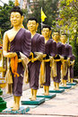 Free Row Of Monks Receive Food Royalty Free Stock Photography - 19016897