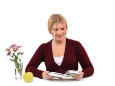 Free Pretty Female With Green Apple Reading Book Stock Image - 19014601