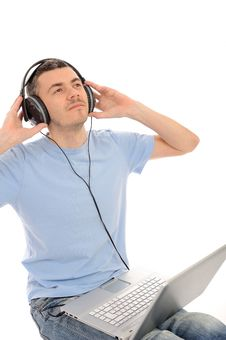 Casual Man Listening To Music In Headphones Royalty Free Stock Photography
