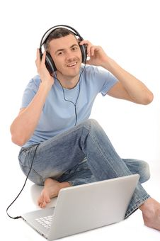 Casual Man Listening To Music In Headphones Royalty Free Stock Photo