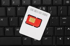 Free SIM Card On Computer Keyboard Stock Photo - 19015630