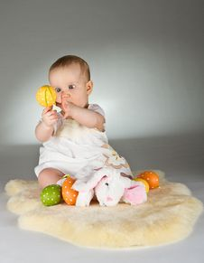 Free Young Cute Baby In An Easter Setting Stock Images - 19016214