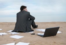 Businessman Sitting On Beach Royalty Free Stock Image