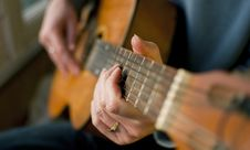Free Brown Guitar In Hands Of The Guy Stock Images - 19023864