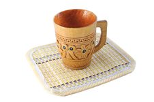 Carved Wooden Cup With A Pattern On A Bamboo Mat Stock Photography
