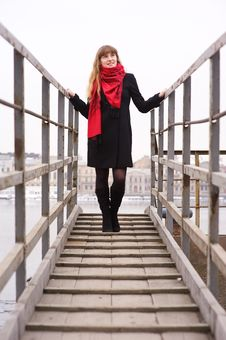 Free Young Girl In The Red Scarf Standing On Stairs Royalty Free Stock Photos - 19028968
