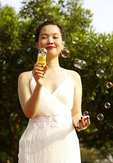 Free Young Woman With Soap Bubbles Royalty Free Stock Photography - 19029417