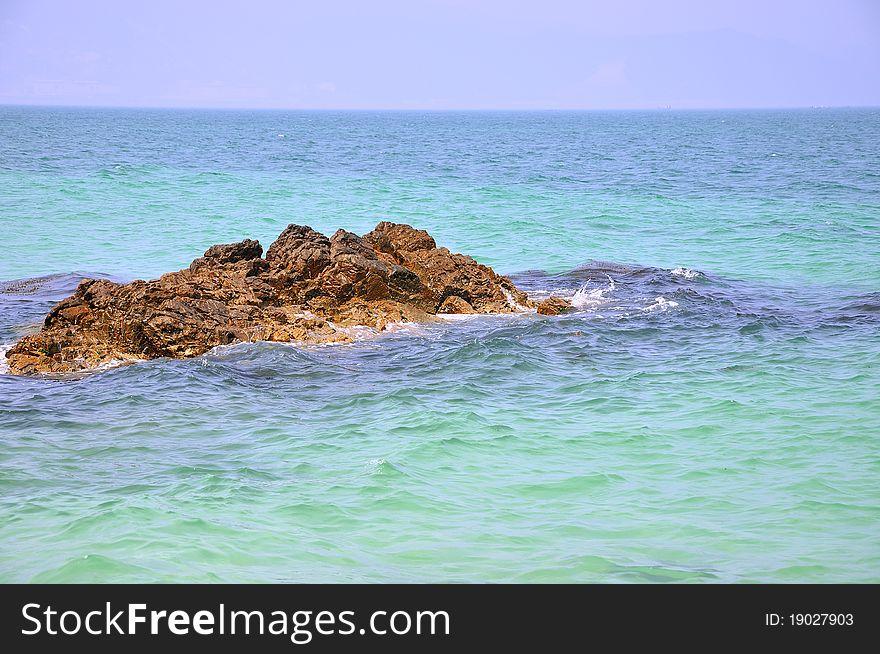 Rock among sea water