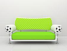 Green Sofa With Football Symbolics Royalty Free Stock Photo
