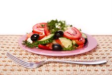 Plate Of Fresh Salad And A Fork On The Napkin Stock Image