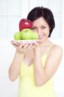 Free Girl Holding Apples Royalty Free Stock Image - 19034296