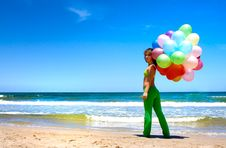 Free Young Woman With Colorful Balloons Royalty Free Stock Image - 19035226