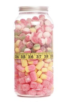 Jar Of Sweets And Tape Measure Royalty Free Stock Photos