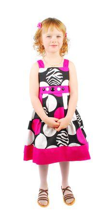 Little Girl In Fashion Dress. Stock Photo