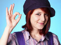Free Beautiful Girl In Shirt And Violet Cap Show OK Royalty Free Stock Image - 19046066