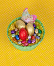Free Colorful Easter Chocolate Eggs In A Green Basket Royalty Free Stock Image - 19049666