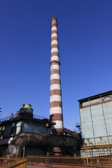 Disused Steel Plant Chimney With Blue Sky Stock Image
