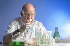 Free Scientist Working With Chemicals Royalty Free Stock Photo - 19041455