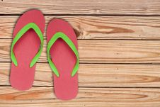 Free Red Ang Green Flip Flop Sandals On Wood Royalty Free Stock Photos - 19042748