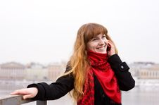 Free Young Girl In The Red Scarf Calling On Phone Stock Photography - 19043792