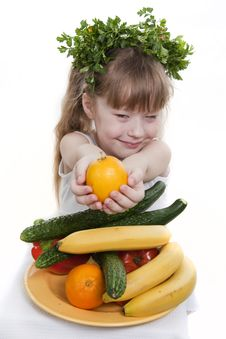 Free Child Holds Vegetables And Fruit. Stock Images - 19044494