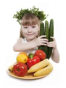 Child Holds Vegetables And Fruit. Stock Image