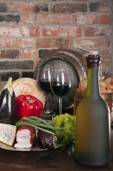 Still Life With Wine And Some Vegetablea Stock Photo